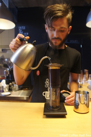 Barista Diego making coffee using AeroPress